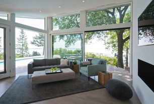 Modern Living Room with Peggy Mid-Century Sofa, Concrete tile , Heath Chair, Transom window, High ceiling