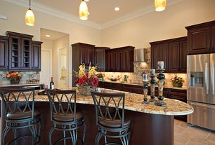 Traditional Kitchen with limestone tile floors, full backsplash, Multiple Refrigerators, Flush, Crown molding, Stone Tile