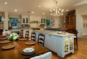 Country Kitchen with Breakfast bar, Custom hood, Ceramic Tile, Kitchen island, Simple granite counters, Chandelier, L-shaped