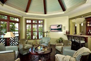 Traditional Living Room with Hardwood floors, Pendant light, Exposed beam, Built-in bookshelf, High ceiling
