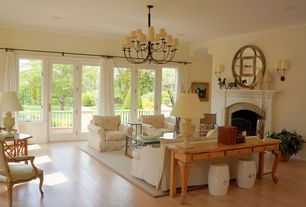 Traditional Living Room with Cement fireplace, Chandelier, Wall sconce, Hardwood floors, French doors