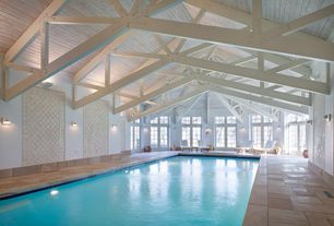 Contemporary Swimming Pool with Transom window, Exposed truss ceiling, travertine tile floors, French doors, Wall sconce