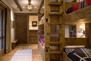 Rustic Guest Bedroom with specialty door, flush light, French doors, Built-in bookshelf, Exposed beam, Hardwood floors