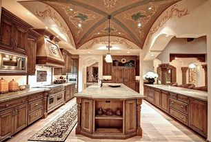 Mediterranean Kitchen with Complex granite counters, can lights, Pendant light, Complex Granite, Framed Partial Panel