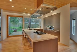 Contemporary Kitchen with Breakfast bar, High ceiling, Undermount sink, Travertine counters, Flush, Exposed wood ceiling
