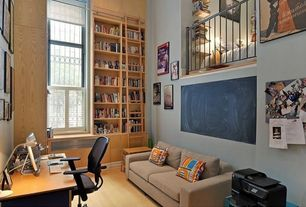 Traditional Home Office with Standard height, Bamboo floors, Built-in bookshelf, specialty window, Loft