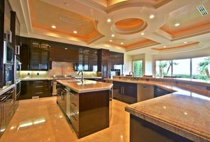 Contemporary Kitchen with Custom hood, Kitchen island, built-in microwave, Crown molding, Undermount sink, can lights, Flush