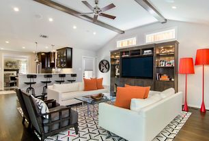 Contemporary Great Room with Ceiling fan, High ceiling, Pendant light, Hardwood floors, French doors, Built-in bookshelf