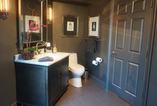 Traditional Powder Room with Raised panel, Wall sconce, Crown molding, specialty door, Complex marble counters, Flush