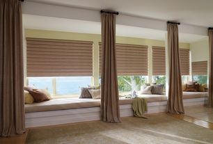 Contemporary Master Bedroom with Loloi Rugs Oakwood Green Area Rug, Window seat, Columns, Laminate floors
