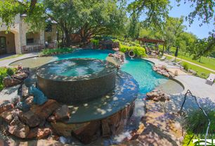 Rustic Hot Tub with exterior stone floors, Glass panel door, Fence, Pool with hot tub, Fountain, Pathway