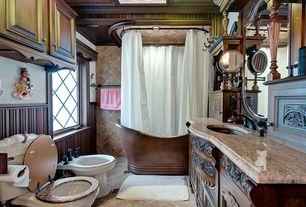 Country Full Bathroom with Full Bath, tiled wall showerbath, Casement, Undermount sink, shower bath combo, stone tile floors