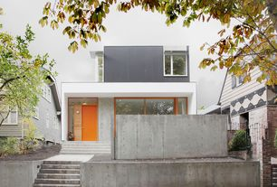 Contemporary Front Door with Raised beds, specialty window