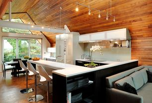 Modern Kitchen with limestone tile floors, Kitchen island, High ceiling, Corian counters, flush light, Breakfast bar, Balcony
