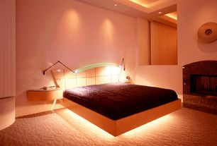 Contemporary Master Bedroom with can lights, bedroom reading light, stone fireplace, Carpet, High ceiling, Fireplace