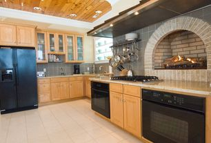 Eclectic Kitchen with Raised panel, Crown molding, limestone tile floors, Large Ceramic Tile, L-shaped, Undermount sink