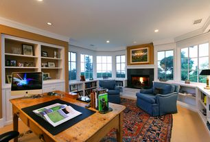 Traditional Home Office with Carpet, Cement fireplace, Window seat, Built-in bookshelf