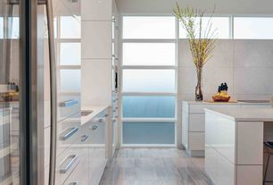 Contemporary Kitchen with stone tile floors, L-shaped, Simple marble counters, Undermount sink, specialty window, Flush