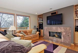 Craftsman Living Room with stone fireplace, picture window, Fireplace, Hardwood floors, can lights, Built-in bookshelf