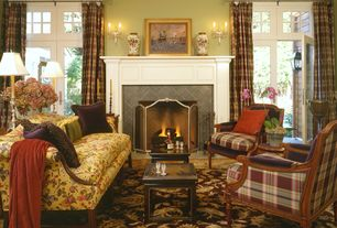 Traditional Living Room with stone fireplace, Transom window, Carpet, Wall sconce, French doors, Built-in bookshelf