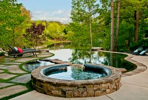 Traditional Swimming Pool with exterior stone floors, Infinity pool, Pathway, Fence, Outdoor chaise lounge chair