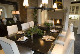 Contemporary Dining Room with Chandelier, Cement fireplace, Hardwood floors