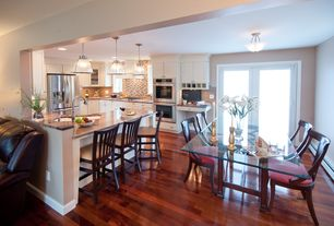 Contemporary Kitchen with Natural light, Undercabinet lighting, French doors, Glass dining table, Hardwood floors