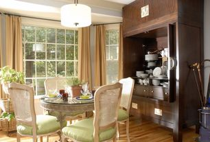 Traditional Dining Room with double-hung window, Built-in bookshelf, flush light, Hardwood floors, specialty window
