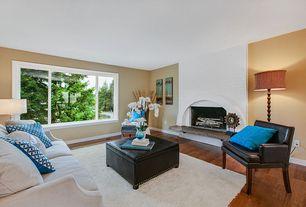Modern Living Room with Casement, Standard height, Fireplace, brick fireplace, Hardwood floors