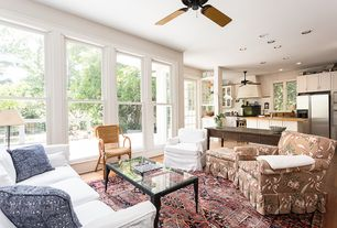 Traditional Living Room with Ceiling fan, Hardwood floors, French doors