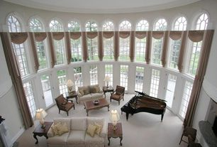 Contemporary Living Room with Concrete floors, French doors, Arched window, Cathedral ceiling