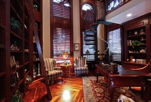 Traditional Home Office with can lights, Arched window, Built-in bookshelf, Casement, High ceiling, Loft, Hardwood floors