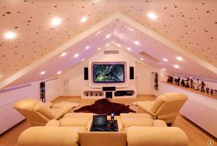 Eclectic Home Theater with Built-in bookshelf, Cathedral ceiling, can lights, Exposed beam, flat door, Hardwood floors