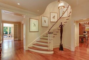 Traditional Staircase with Hardwood floors, High ceiling, can lights, Pendant light, curved staircase