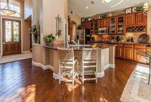Mediterranean Kitchen with flush light, built-in microwave, Stone Tile, Raised panel, French doors, Framed Partial Panel