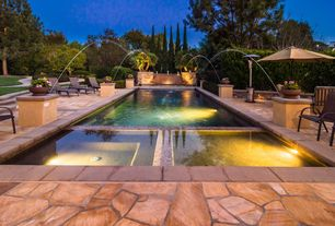 Contemporary Swimming Pool with exterior stone floors, Pool with hot tub, Pathway, Raised beds