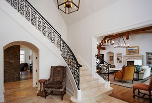 Modern Staircase with Chandelier, limestone floors, High ceiling