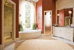 Traditional Master Bathroom with Flush, limestone floors, Arched window, Master bathroom, Simple marble counters, Rain shower