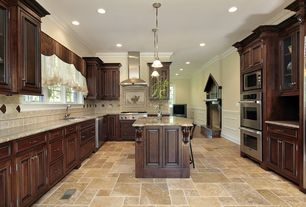 Traditional Kitchen with Complex granite counters, Undermount sink, High ceiling, Limestone Tile, Dark wood cabinets