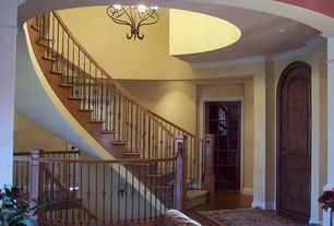 Traditional Staircase with Hardwood floors, Crown molding, Glass panel door, High ceiling
