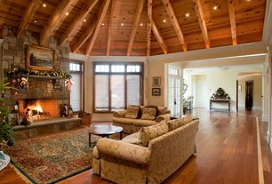 Traditional Living Room with Exposed beam, Kinkaid traditional skirted oversized sofa, Paint 1, Casement, French doors