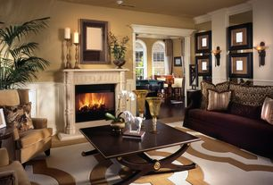 Contemporary Living Room with Carpet, Crown molding, Wainscotting, Wall sconce, Cement fireplace, Arched window