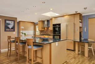 Contemporary Kitchen with Ceramic Tile, Crown molding, L-shaped, Flush, full backsplash, Skylight, Glass panel, can lights