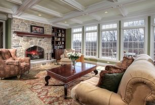 Traditional Living Room with Crown molding, Box ceiling, Built-in bookshelf, stone fireplace, Carpet