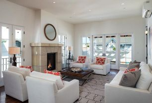 Contemporary Living Room with French doors, Hardwood floors, stone fireplace, Wall sconce