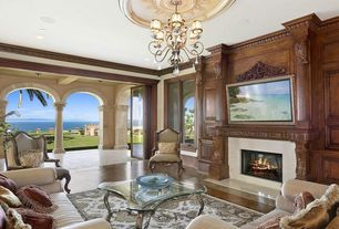 Traditional Living Room with Chandelier, Fireplace, picture window, Cement fireplace, Standard height, Hardwood floors