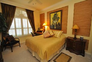 Traditional Guest Bedroom with Carpet, Ceiling fan, Crown molding