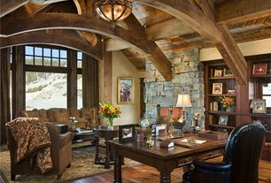 Rustic Home Office with Columns, can lights, Hardwood floors, Exposed beam, flush light, picture window, High ceiling
