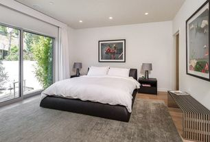 Contemporary Guest Bedroom with Laminate floors