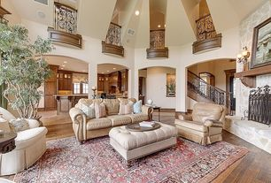 Mediterranean Great Room with stone fireplace, High ceiling, can lights, Hardwood floors, Fireplace